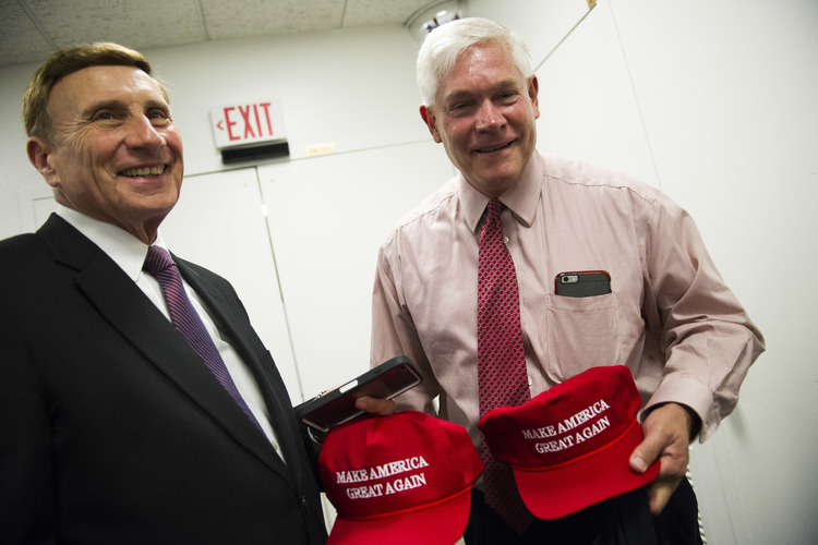 "Rep. John Mica (R-Fla.), left, and Rep. Pete Sessions (R-Texas), right, display their ""Make America Great Again"" hats after attending a House Republican leadership meeting in the Capitol on Tuesday. (Cliff Owen/AP)</p>"