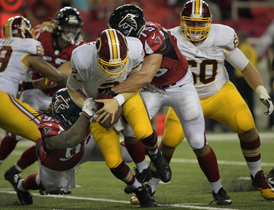 Redskins quarterback Nate Sudfeld is sacked last night by Atlanta s Nordly  Capi and Brandon Williams in the 4th quarter. (Photo by John McDonnell The  ... dc58888d11c3