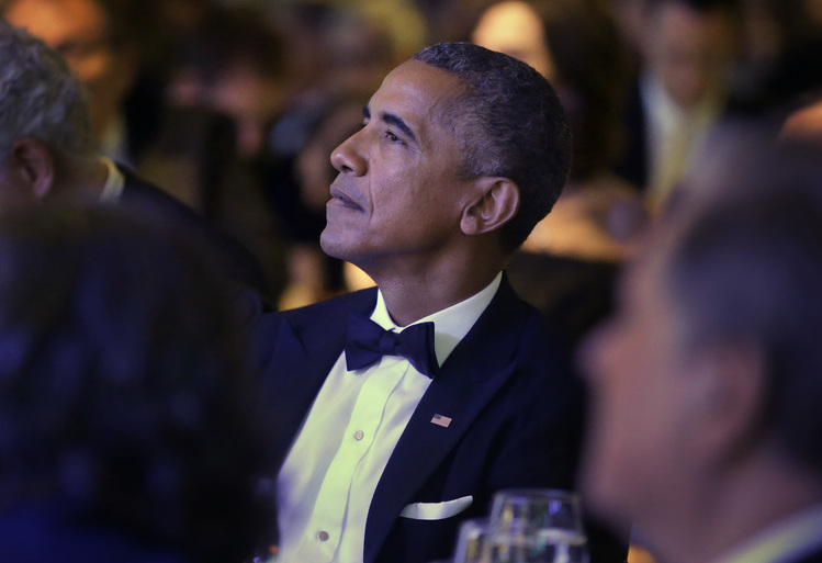 Barack Obama listens to musician James Tayorperform before accepting the 2017 Profile in Courage award at the John F. Kennedy Presidential Library last night. (Steven Senne/AP)/p