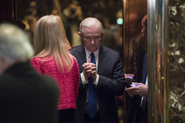 Jeff Sessions boards an elevator at Trump Tower yesterday. (Jabin Botsford/The Washington Post)</p>