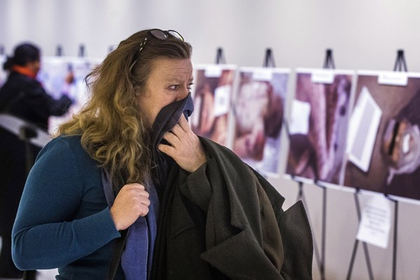 A woman looks at a collection of gruesome images compiled by the Syrian photographer known as Caesar on display at U.N. headquarters in New York in 2015. (Lucas Jackson/Reuters)