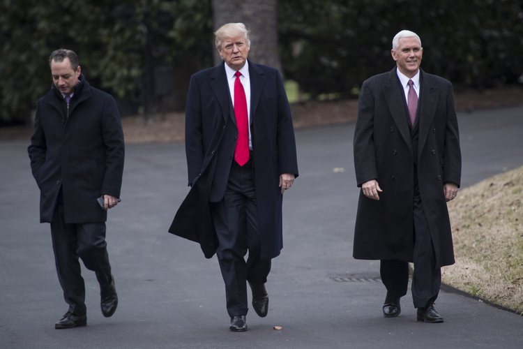 Trump, Mike Pence, and Reince Priebus walk on the south lawn of the White House. (Jabin Botsford/The Washington Post)</p>