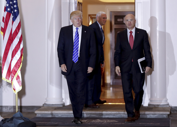Trump walks with Andy Puzder in Bedminster, N.J., last month. (Carolyn Kaster/AP)</p>