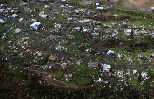 In this file photo, homes and other buildings destroyed by Hurricane Maria lie in ruins in Toa Alta, Puerto Rico. (AP Photo/Gerald Herbert, File)