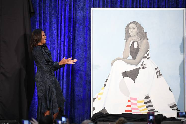 Michelle Obama stands next to her portrait at the Smithsonian National Portrait Gallery. (Matt McClain/The Washington Post)
