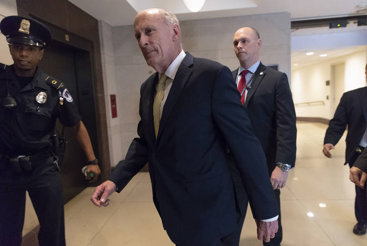 Dan Coats arrives on Capitol Hill to deliver a classified briefing to lawmakers. (J. Scott Applewhite/AP)