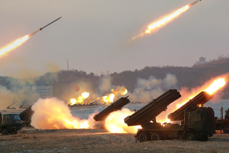 North Korea's Central News Agency released this undated photo of multiple rocket launchers being fired during a drill./p