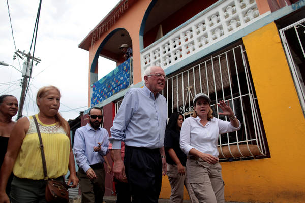 Sen. Bernie Sanders (I-Vt.) and San Juan Mayor Carmen Yulin Cruz visit a neighborhood in San Juan, Puerto Rico. (REUTERS/Alvin Baez)