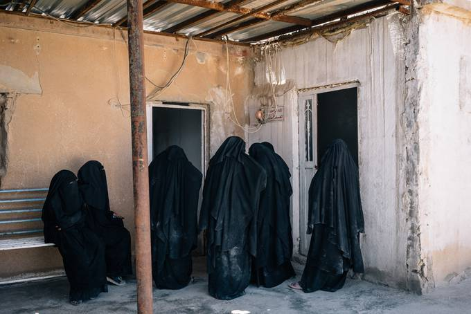 Women stand at a registration office at al-Hol camp in Syria on May 30, 2019. (Alice Martins/For The Washington Post)