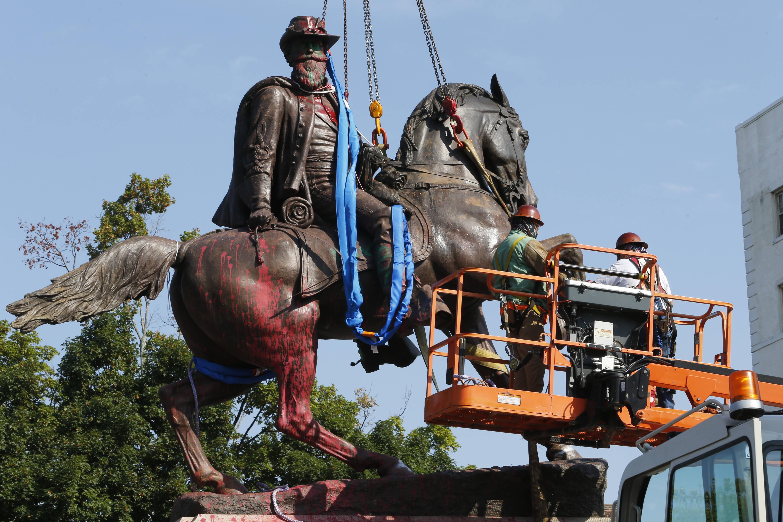Crews prepare to remove a statue of Confederate Gen. J.E.B. Stuart in Richmond on July 7. (Steve Helber/AP)