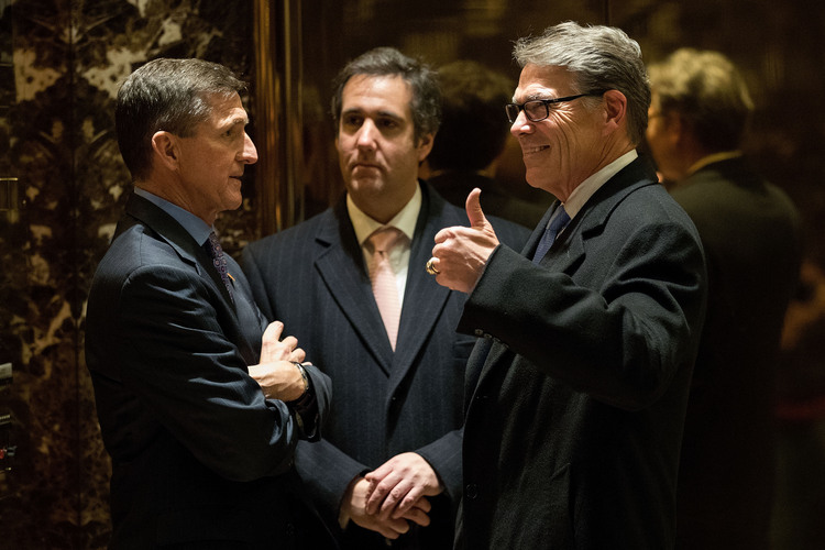 Michael Flynn,  Michael Cohen, and Rick Perry speak in the lobby of Trump Tower during the transition. (Drew Angerer/Getty)/p