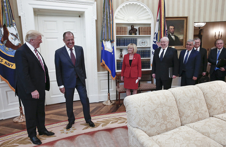 Donald Trump huddles with Sergey Lavrov, Vladimir Putin's top diplomat, at the White House last Wednesday. Fourth from the right is Russian Ambassador Sergei Kislyak. (Handout from the Russian Foreign Ministry Photo/Via AP)/p