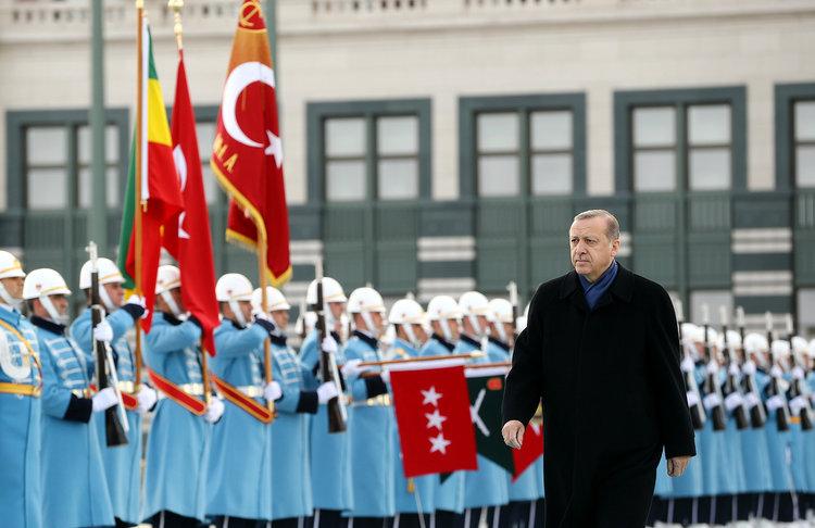 An honor guard greets Turkish President Tayyip Erdogan at his palace in Ankara. (Kayhan Ozer/Presidential Palace/Handout via Reuters)/p