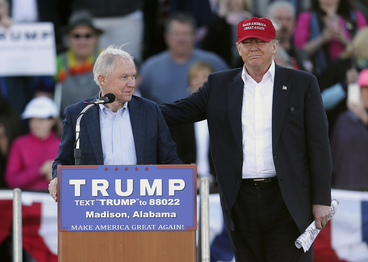 Donald Trump campaigns in February with Jeff Sessions in Alabama. Trump will nominate the senator to be his attorney general. (John Bazemore/AP)</p>