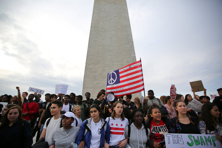 Students attend a protest against President-elect Donald Trump at the National Mall. (Reuters/Carlos Barria)</p>