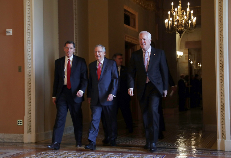 John Barrasso, Mitch McConnell and John Cornyn leave a meeting of Senate Republicans. (Alex Wong/Getty Images)</p>