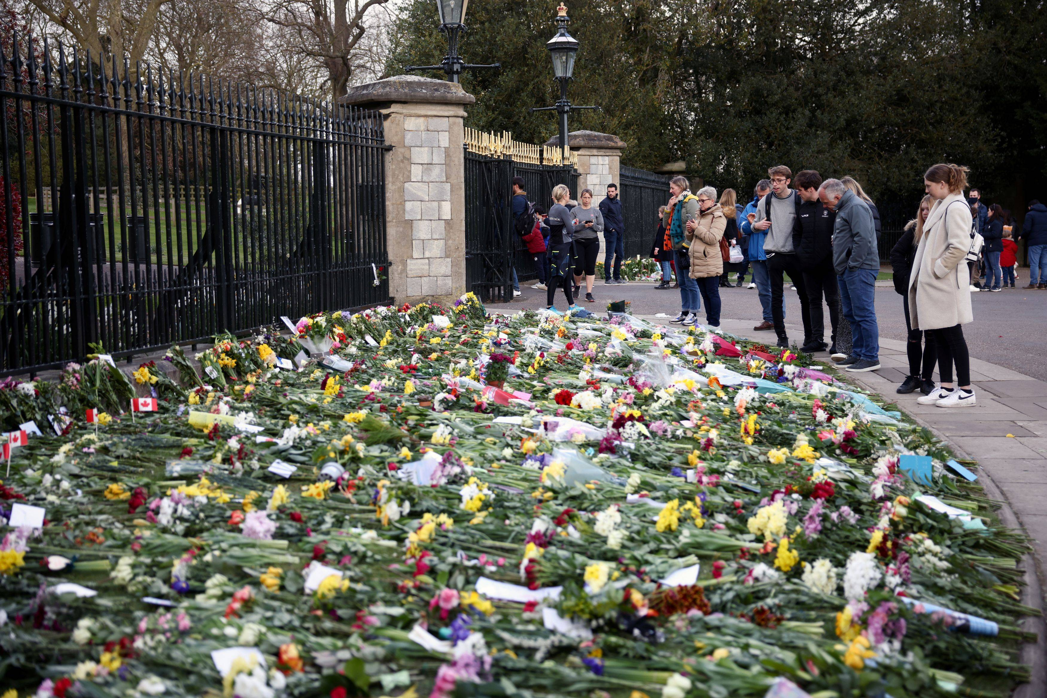 Signs of mourning were everywhere in Britain on Sunday, as churches across the country held remembrance services for Prince Philip, who died Friday at 99. Well-wishers have left hundreds of floral tributes outside Windsor Castle, but some Britons are growing frustrated with the amount of attention lavished on the departed monarch. More than 125,000 people have died of the coronavirus in the United Kingdom over the past year, and some fear that wall-to-wall coverage of the royals is overshadowing other issues of major national concern, like the rising unrest in Northern Ireland. (Henry Nicholls/Reuters)