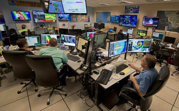 Forecasters at the National Hurricane Center in Miami monitoring Hurricane Irma. (AP Photo/Andy Newman)