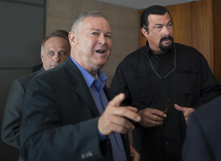 Dana Rohrabacher, actor Steven Seagal and Rep. Steve King (R-Iowa) speak to the media at the U.S. Embassy in Moscow in 2013. Rohrabacher led a a congressional delegation to Russia. (Alexander Zemlianichenko/AP)/p