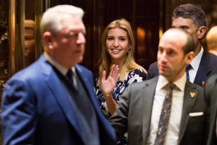 Ivanka Trump waves from the elevator as Al Gore leaves Trump Tower. (Dominick Reuter/AFP/Getty Images)</p>