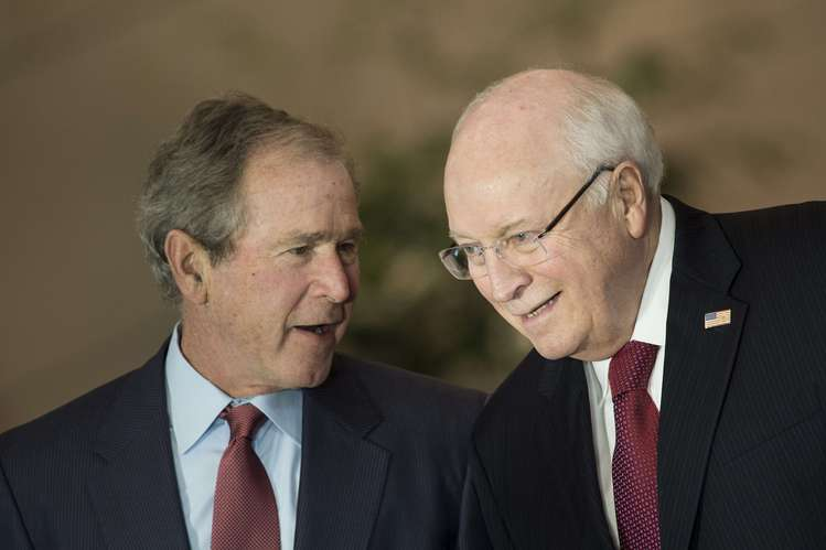 George W. Bush and Dick Cheney talk last December during a ceremony at the Capitol. (Brendan Smialowski/AFP/Getty Images)</p>
