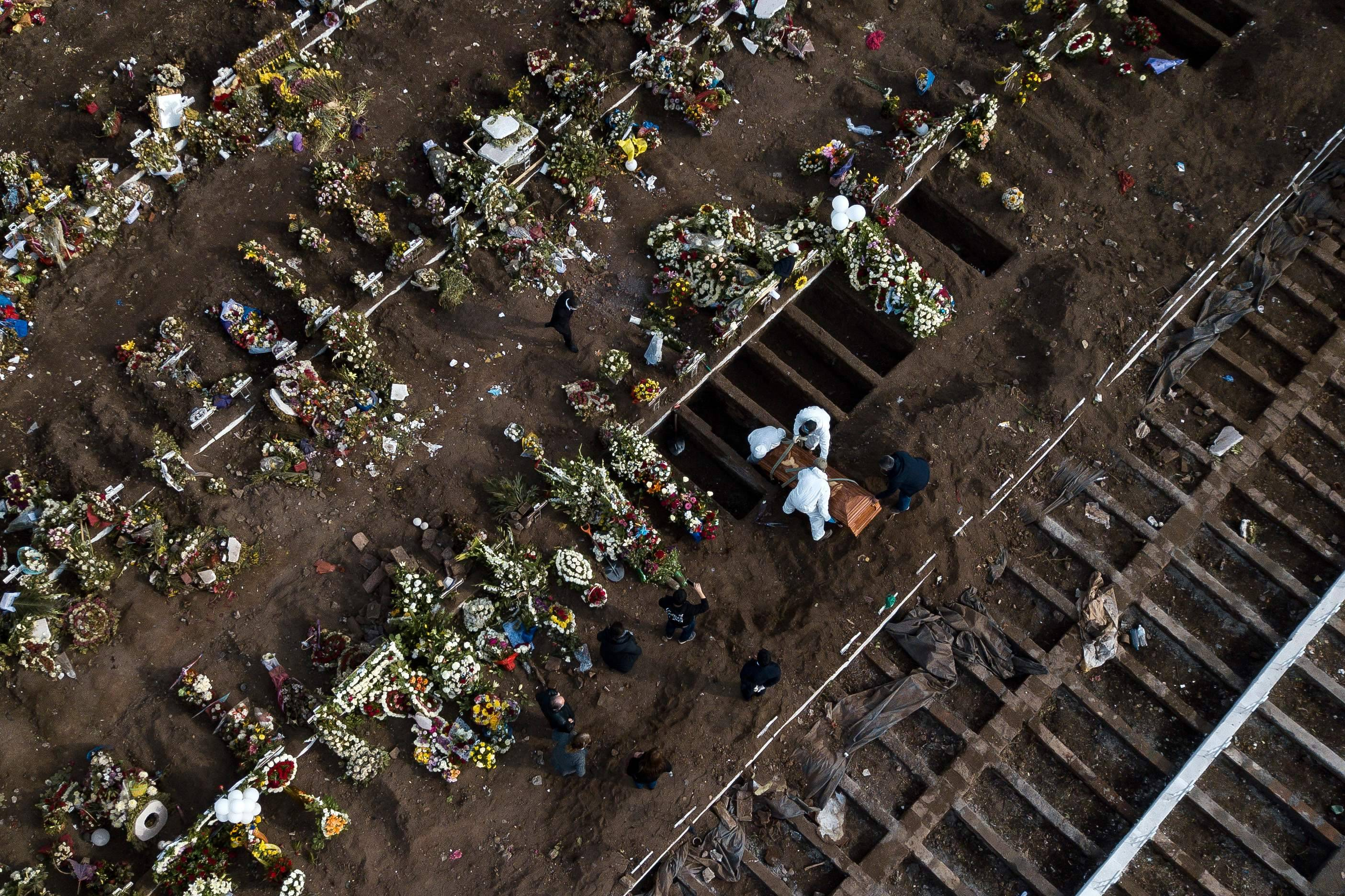 The burial of a victim of covid-19 at the General Cemetery in Santiago on June 15. (Javier Torres/AFP/Getty Images)