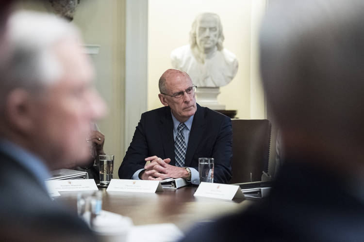 Director of National Intelligence Dan Coats listens to President Trump during a Cabinet meeting at the White House last July. (Jabin Botsford/The Washington Post)
