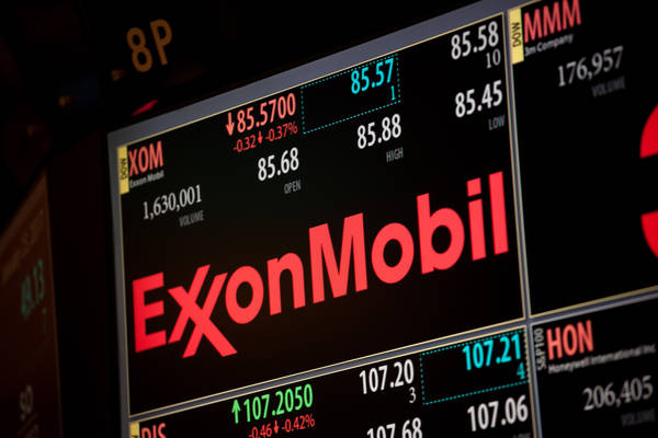 A monitor displays Exxon Mobil Corp. signage on the floor of the New York Stock Exchange. (Michael Nagle/Bloomberg)