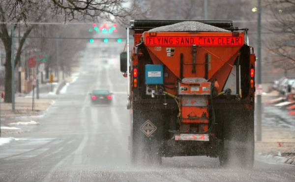 In this file photo, a city truck spreads salt on Q Street in Lincoln, Neb. (Eric Gregory/The Journal Star via AP, File)