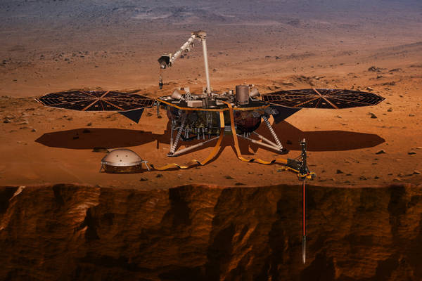 This illustration made available by NASA in 2018 shows the InSight lander drilling into the Martian surface. (NASA via AP)