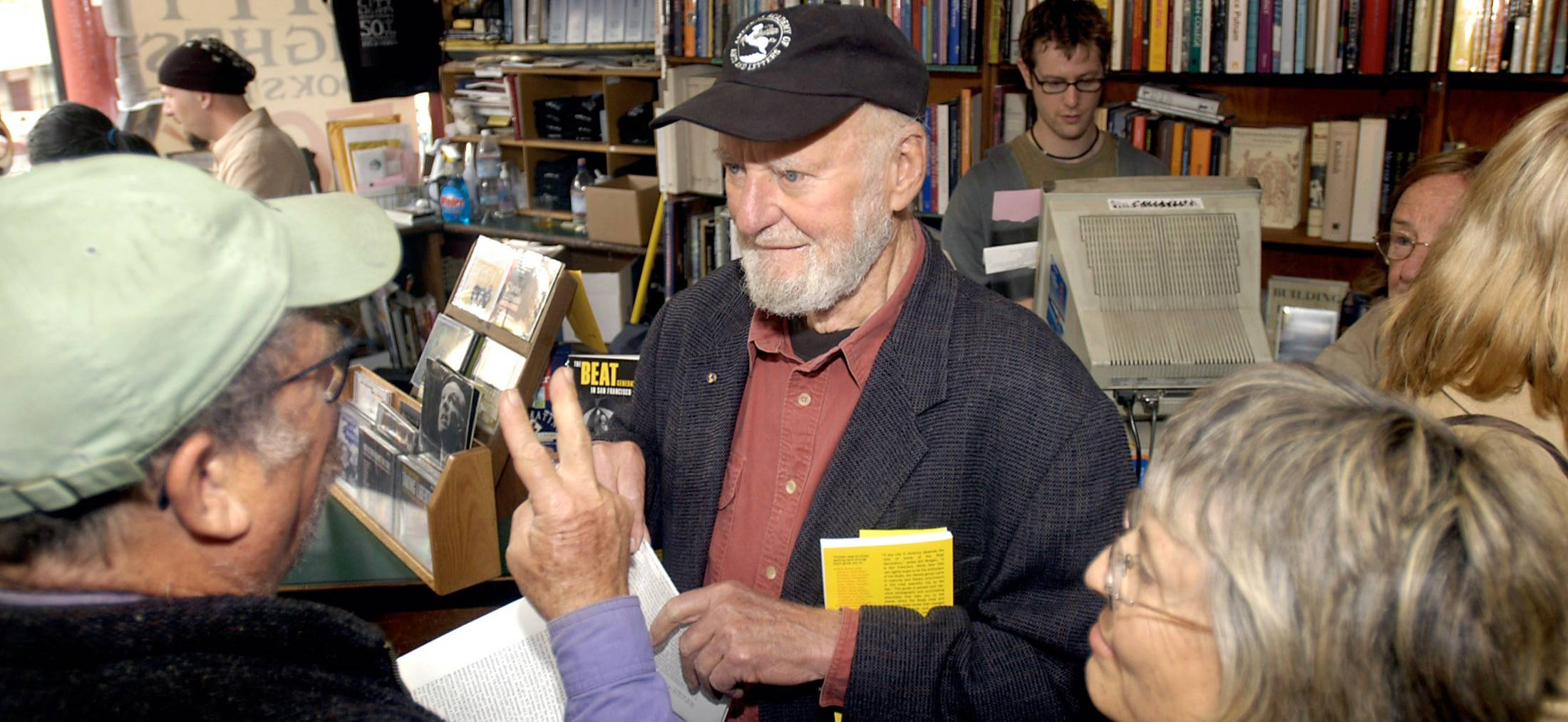 Lawrence Ferlinghetti, co-founder of San Francisco's City Lights Bookstore, makes his way through a crowd of well-wishers at the 50th anniversary of the store in 2003. (Thor Swift/FTWP)