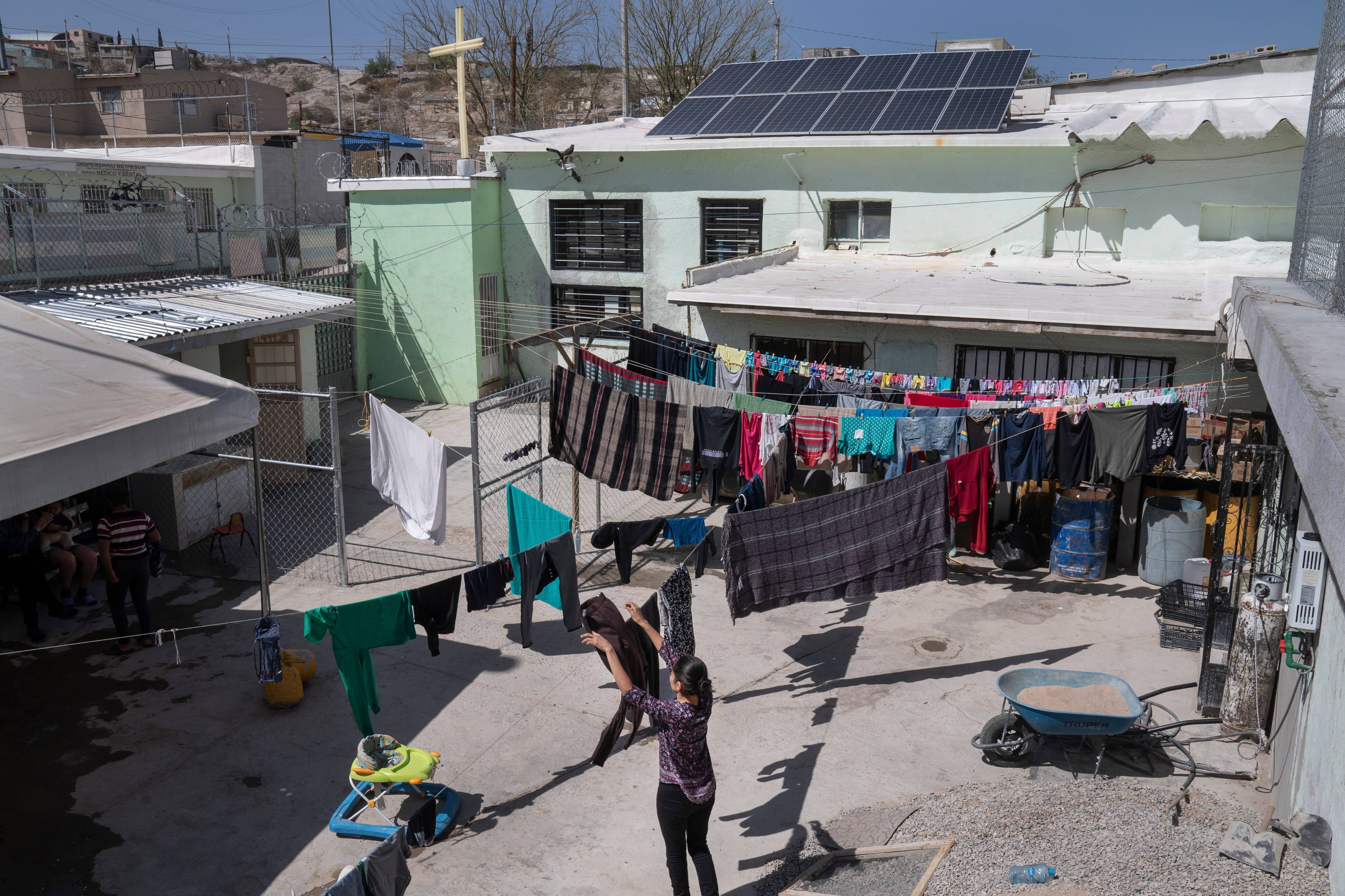 Migrants hang clothes to dry at a shelter in Ciudad Juarez. (Photo by Michael Robinson Chavez/The Washington Post)