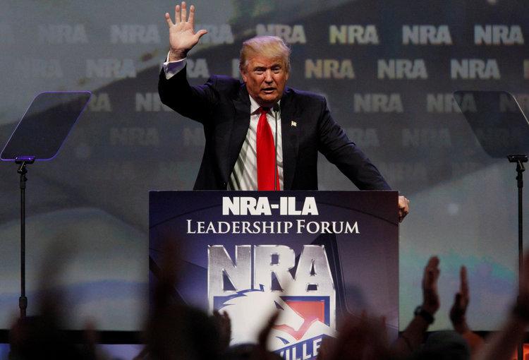 Trump addresses last year's NRA meeting in Louisville. (John Sommers II/Reuters)/p