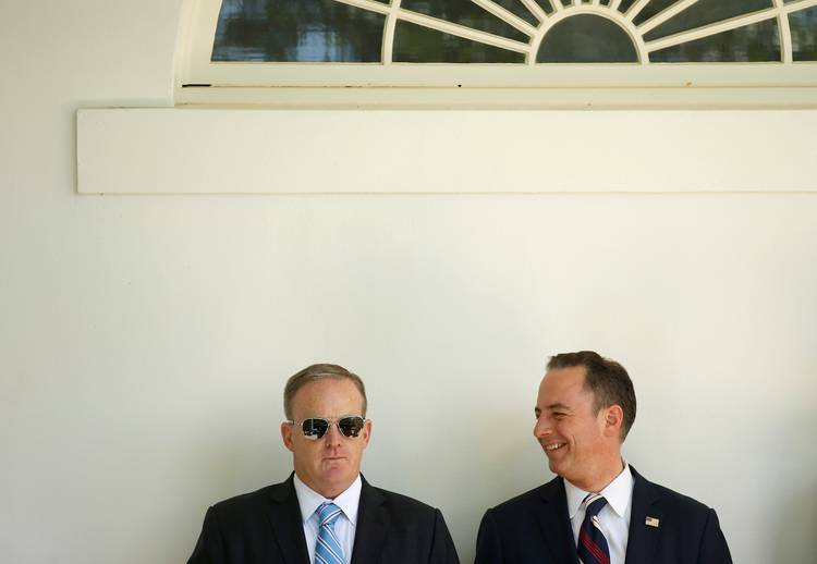 Sean Spicer and Chief of Staff Reince Priebus watch Trump present the U.S. Air Force Academy football team with a trophy in May 2017. (Joshua Roberts/Reuters)