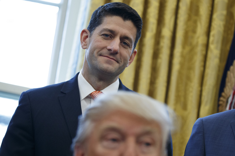 Paul Ryan watches Donald Trump signs House Joint Resolution 41 in the Oval Office on Valentine's Day. (Evan Vucci/AP)/p