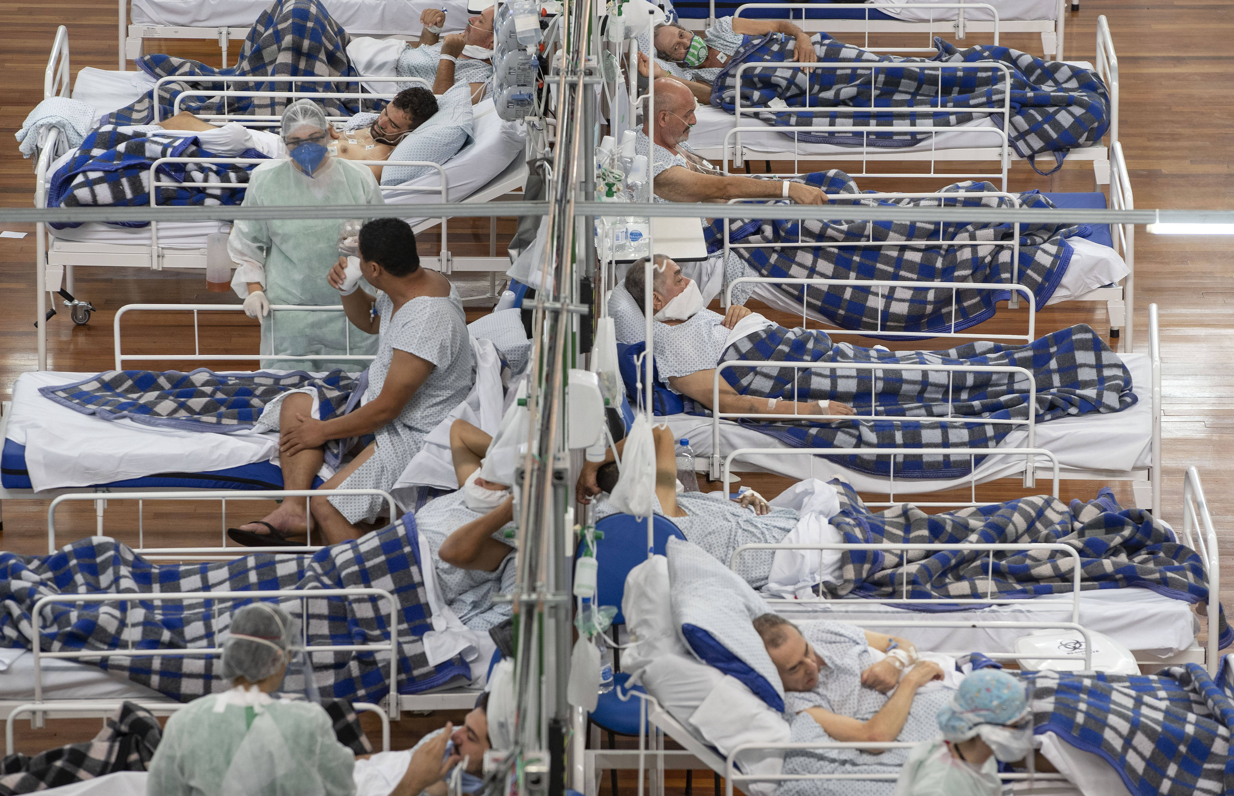 Patients at a field hospital set up inside a gym on the outskirts of Sao Paulo, Brazil, on Tuesday. (Andre Penner/AP)