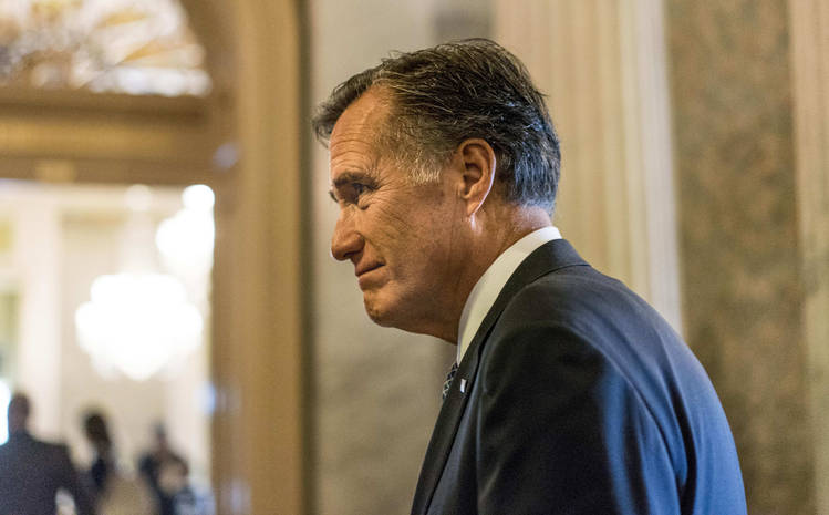 Mitt Romney leaves a meeting in Senate Majority Leader Mitch McConnell's office in the Capitol. (Melina Mara/The Washington Post)