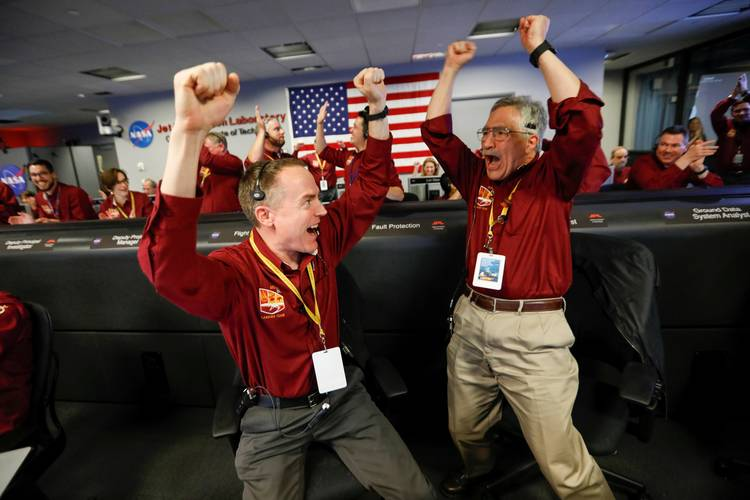 NASA engineers celebrate at the space agency's Jet Propulsion Laboratory in Pasadena, Calif., as the spaceship InSight lands on the surface of Mars after a six-month journey. (Al Seib/Pool/Reuters)