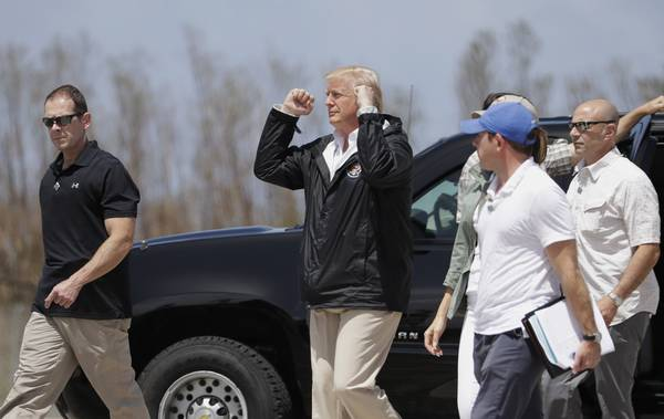 President Trump gestures after arriving at the Luis Muñiz Air National Guard Base. (AP Photo/Evan Vucci)