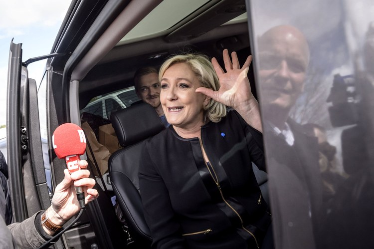 National Front candidate Marine Le Pen visits the Whirlpool plant in Amiens, in northern France, yesterday. She's the underdog going into the May 7 runoff. (Christophe Petit Tesson/EPA)/p