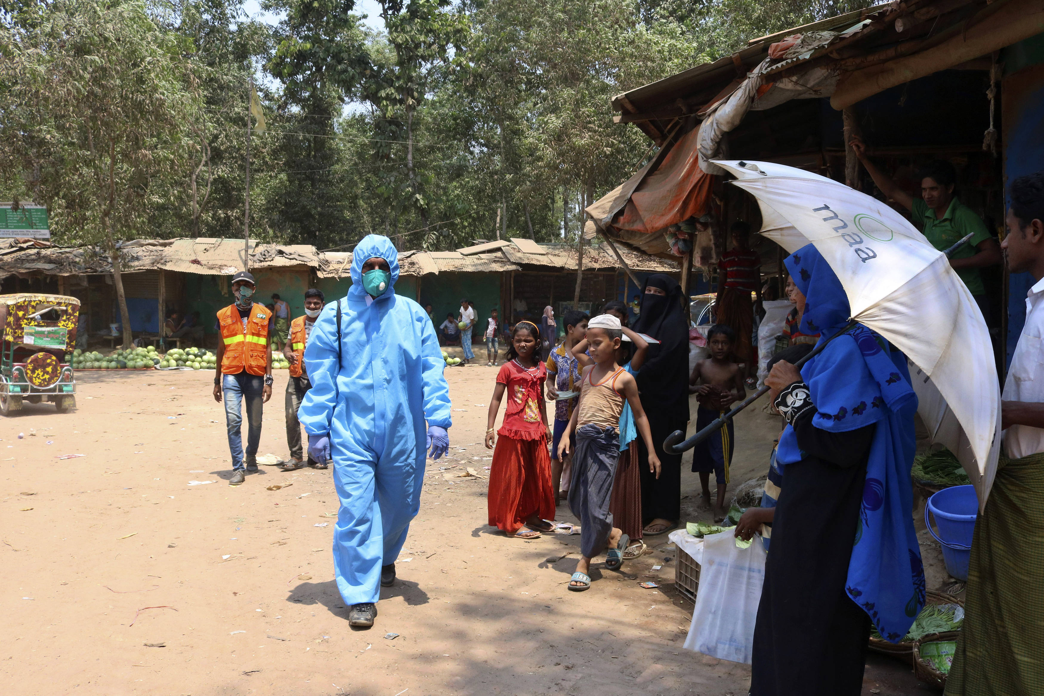 A health worker in a hazmat suit last month at the Kutupalong Rohingya refugee camp in Bangladesh. (Shafiqur Rahman/AP)