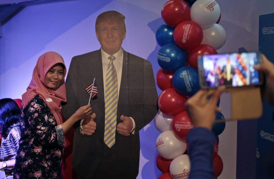 abb62c09d7c A Muslim woman gets her photo taken with a cardboard cutout of Donald Trump  at the U.S. embassy s cultural center in Jakarta