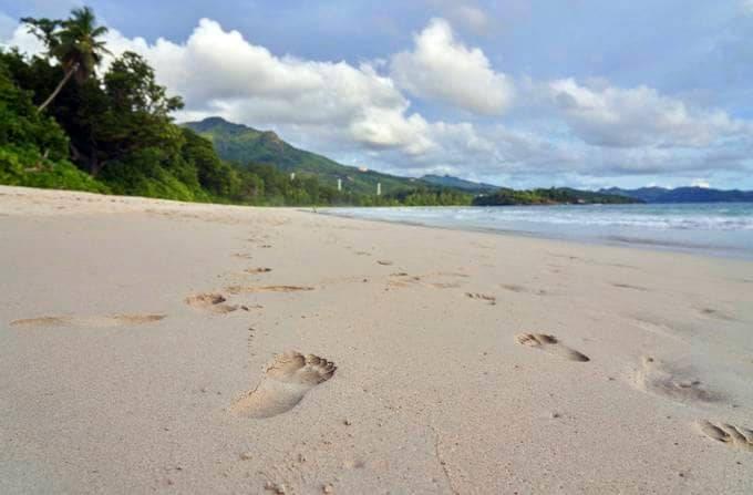 Footprints dot the sand on the beach on Mahe island, Seychelles in March 2019. (AP Photo/David Keyton)