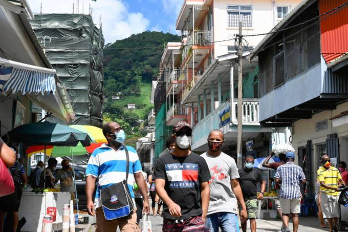 Shoppers wearing masks are seen in Victoria, Seychelles on April 2. (The Yomiuri Shimbun via AP Images)