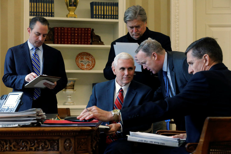 Reince Priebus, Mike Pence, Steve Bannon, Sean Spicer and Michael Flynn listen at Trump speaks by phone with Vladimir Putin on Jan. 28. (Jonathan Ernst/Reuters)</p>