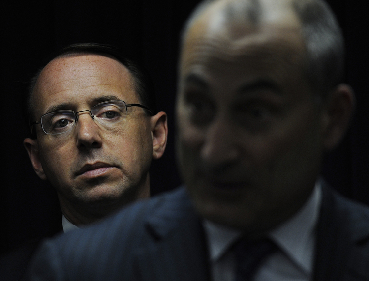Rod Rosenstein (L) listens during a press conference. (Michael S. Williamson/The Washington Post)/p