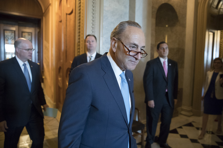 Chuck Schumer enters a meeting of Senate Democrats to discuss the response to Comey being fired. (J. Scott Applewhite/AP)/p