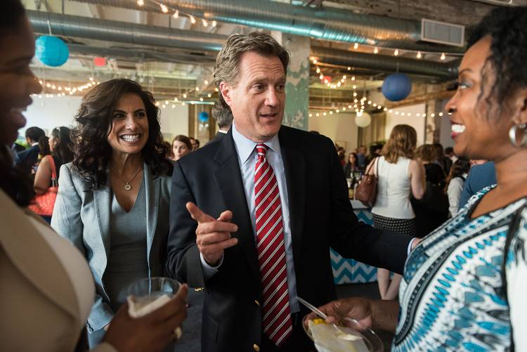 Rep. Mike Turner (R-Ohio) talks to two people as his then-fiancee Majida Mourad laughs at his side during a happier time. (Kate Warren for The Washington Post)