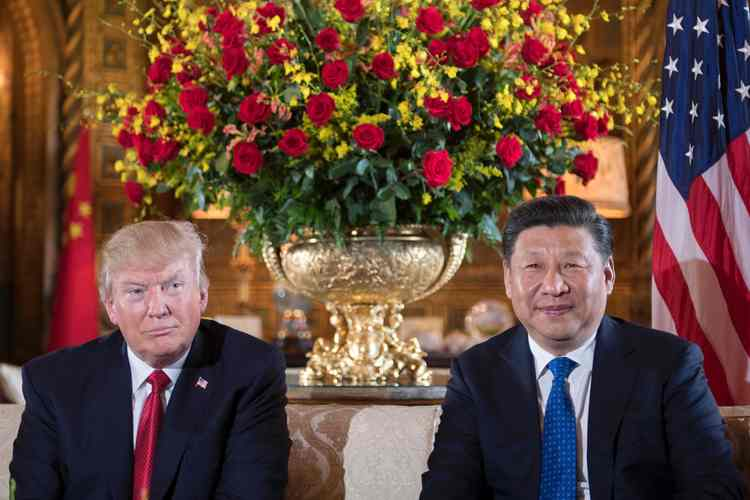 Donald Trump and Chinese President Xi Jinping (R) attend a bilateral meeting at Mar-a-Lago in April. (Jim Watson/AFP/Getty Images)
