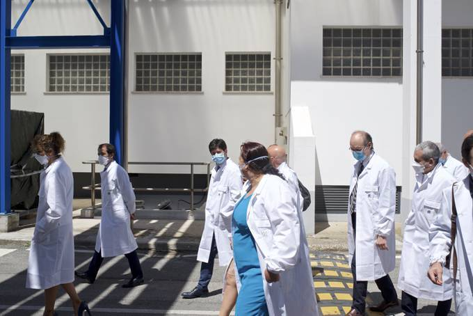 Italian Health Minister Roberto Speranza, center facing camera, tours the IRBM lab Advent. (Geraldine Hope Ghelli for The Washington Post)